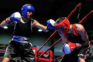 Joshua Franco (left) of San Antonio throws a punch at Adrian Guerra of Dallas at the state Golden Gloves youth boxing tournament at Will Rogers Arena in Fort Worth on Feb. 26, 2014.