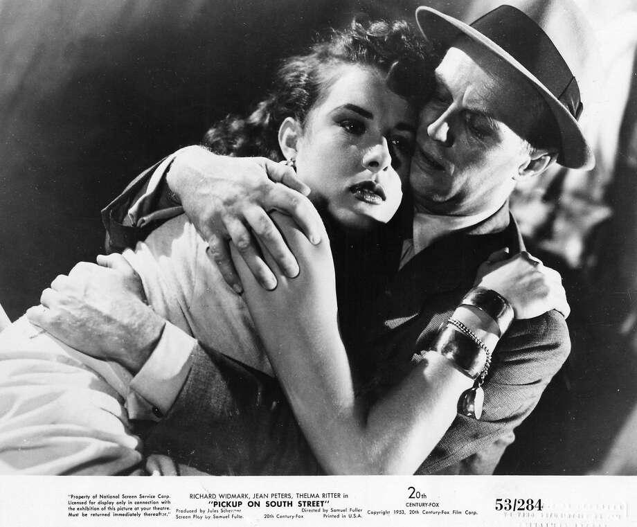 "Jean Peters and Richard Widmark in Samuel Fuller's ""Pickup on South Street"" (1953). Photo: Film Noir Foundation"