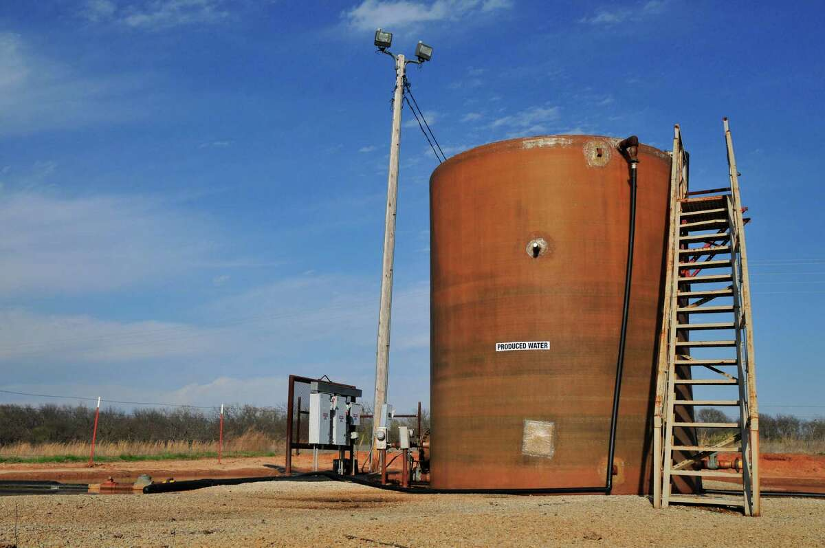 A wastewater holding tank on a drill site in Prague, Okla., is shown. A new University of Texas at Austin study linked oil and gas wastewater disposal with earthquakes. >>What fracking actually looks like