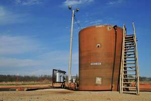 A wastewater holding tank on a drill site in Prague, Okla., is shown. Oklahoma and federal officials ordered the closing of water disposal wells in the wake of Saturday's 5.8 magnitude quake. But that leaves the question of what to do with the water.