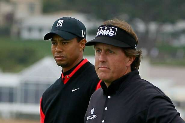 PEBBLE BEACH, CA - FEBRUARY 12: (L-R) Tiger Woods and Phil Mickelson wait on the seventh hole tee during the final round of the AT&T Pebble Beach National Pro-Am at Pebble Beach Golf Links on February 12, 2012 in Pebble Beach, California.  (Photo by Jeff Gross/Getty Images)