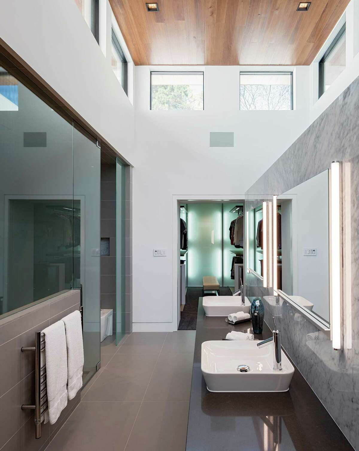 Clerestory windows bring natural light into the master bathroom designed by Messick.