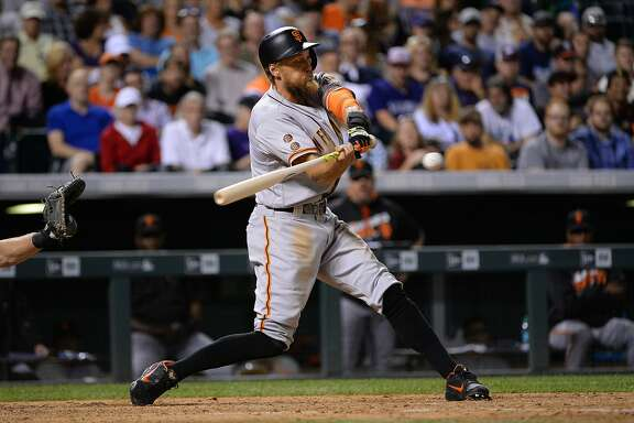 DENVER, CO - SEPTEMBER 7:  Hunter Pence #8 the San Francisco Giants hits a double in the eighth inning against the Colorado Rockies at Coors Field on September 7, 2016 in Denver, Colorado.  Colorado Rockies defeat the San Francisco Giants 6-5. (Photo by Bart Young/Getty Images)
