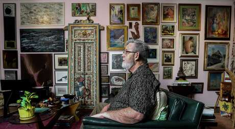Randy Tibbits, one of the city's most avid collectors of early Houston art, in his living room.