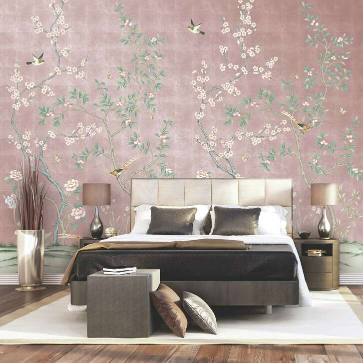 Tempaper's Chinoiserie fabric wallpaper places hand-painted scenes on one of three metallic backgrounds, rose gold, gold or silver.