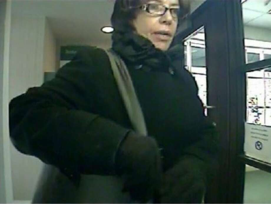 Surveillance video from a Greenwich bank shows Michelle Cantatore before she pulled a paint-ball gun and demanded money in January of 2015. Photo: / GPD