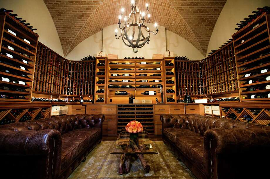 T.J. Farnsworth created a wine room worthy of his vast, 2,000-bottle collection. Specialty rooms for entertaining are almost a given in high-end new home construction. Photo: Michael Ciaglo, Staff / © 2016  Houston Chronicle
