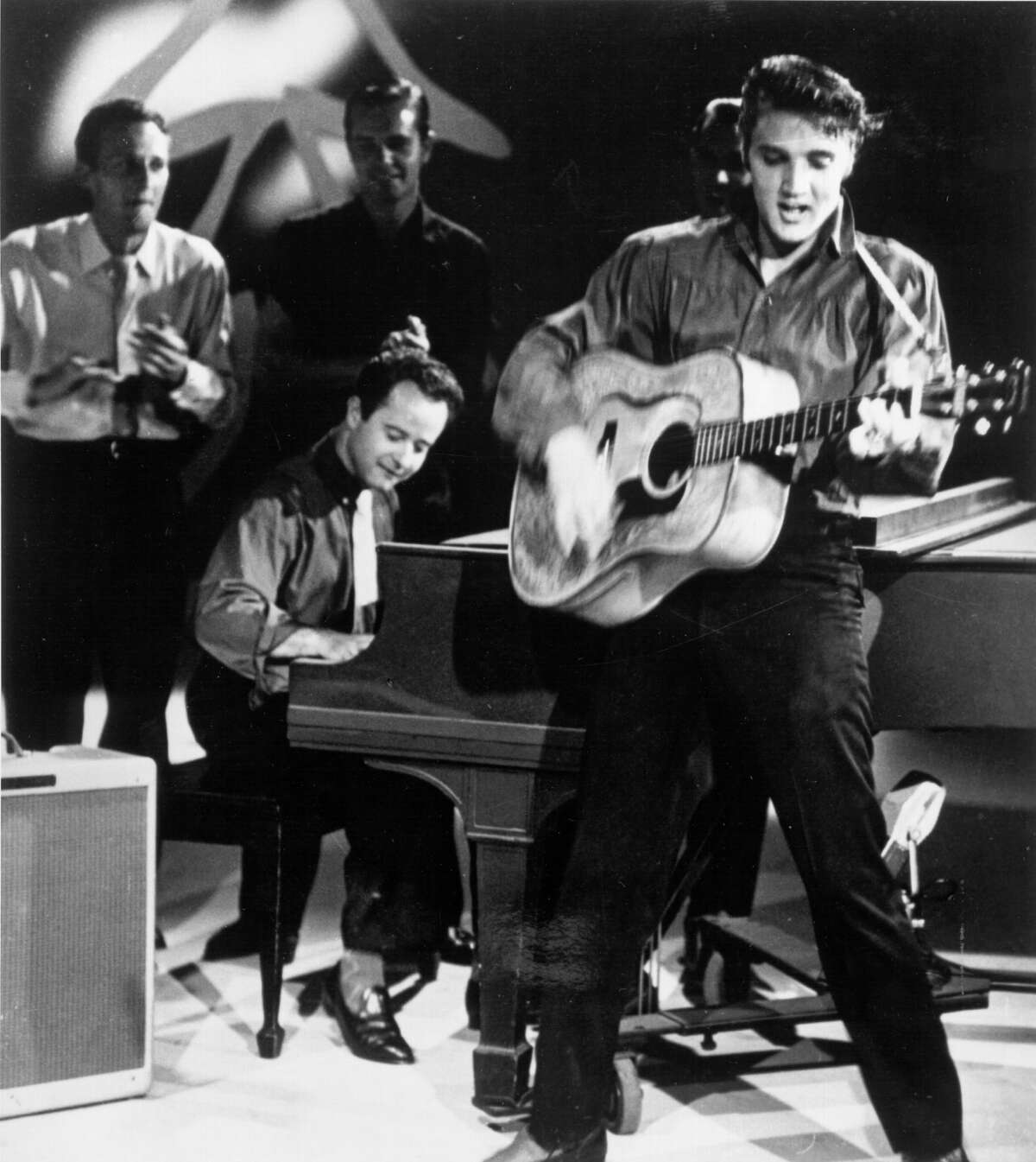 Rock and roll singer Elvis Presley performs on the Ed Sullivan show on September 9, 1956 at CBS Studios in Los Angeles.