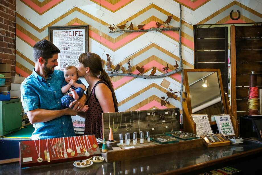 Bespoke boutique owners Brian Hess (left) and Heather River with their son Oberon Hess, 5 months. Photo: Gabrielle Lurie, Special To The Chronicle