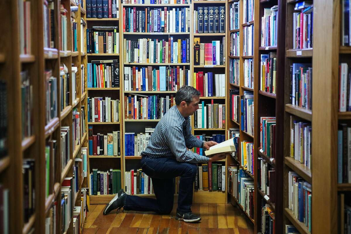 Robert Carroll looks through a book at Booktown Books, in Grass Valley, California, on Saturday, Sept. 3, 2016.