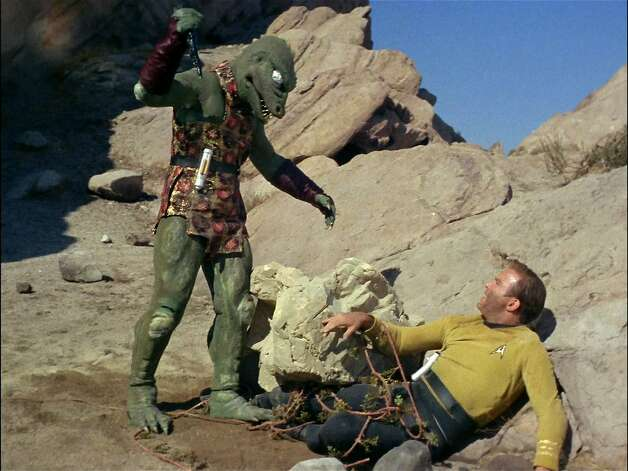 "Gorn on the macabre:Capt. Kirk battles the Gorn to the death for the entertainment of other aliens who captured the pair  in the episode ""Arena."" In 1967, many American households had only black-and-white TV sets, which actually benefited this episode. The lack of color made the Gorn seem more menacing and less like Barney's evil twin. Photo: Getty Images, CBS Via Getty Images"