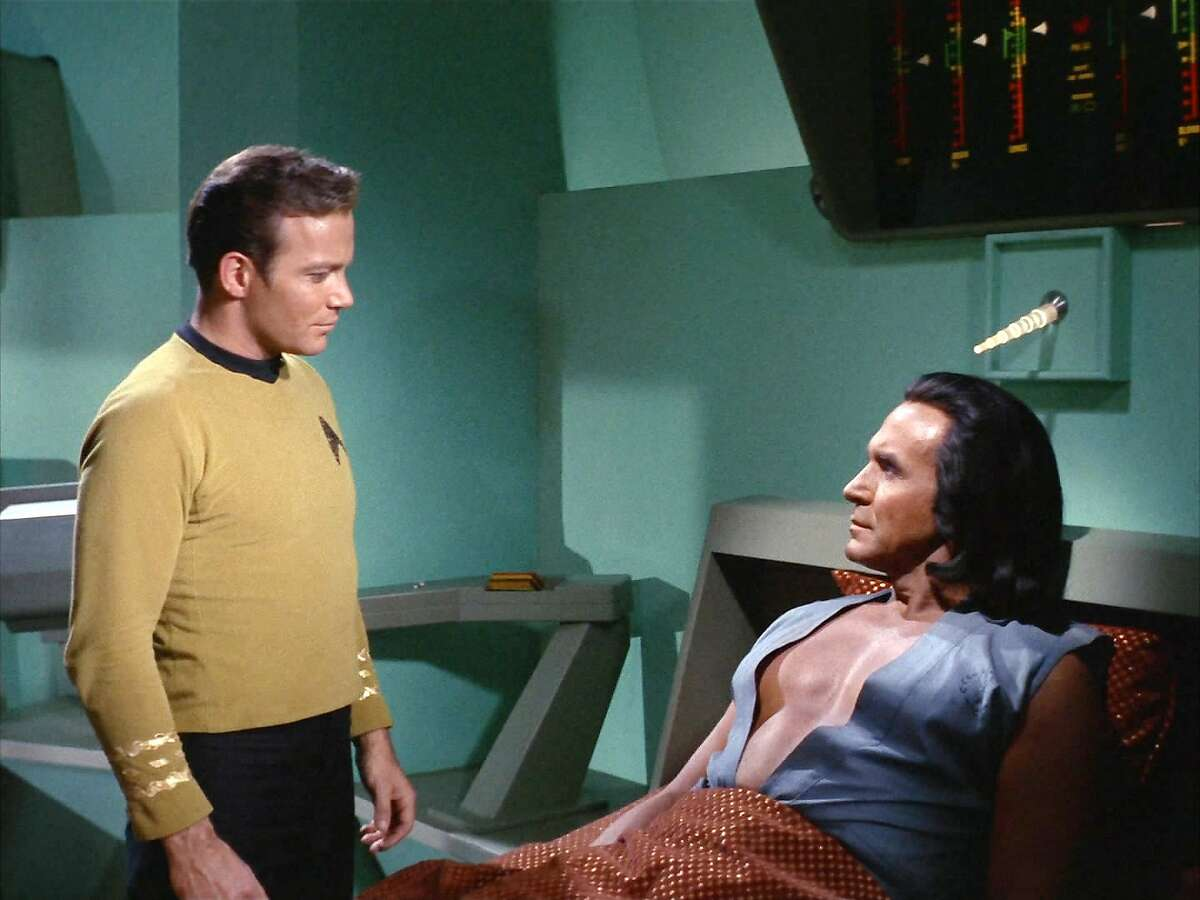 I see your toupee and raise you one shoulder-length wig: The studly Khan (Ricardo Montalban) flaunts his bioengineered pecs at Kirk, making the 5-foot-10 captain look like the 98-pound weakling on the beach. Both men wore hairpieces.
