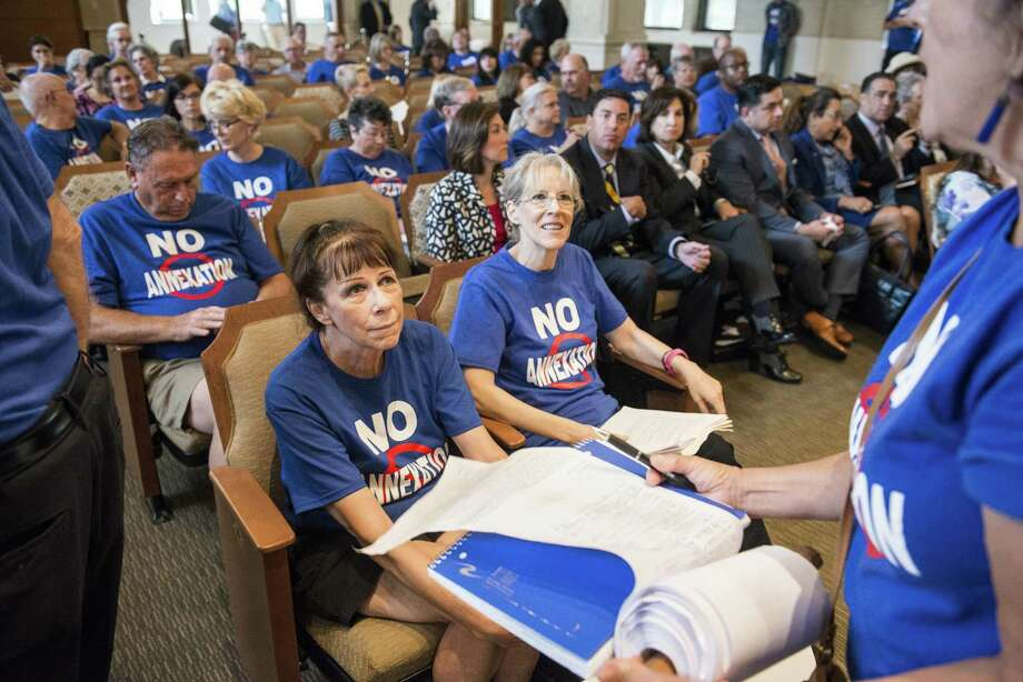 """Sisters Kimberly Vogel, left, and Susan Vogel, right, wearing """"No Annexation"""" t-shirts, sit in the front row during a San Antonio City Council meeting where they voted on whether to annex several parts of unincorporated Bexar County, notable a 15-square mile area along Interstate 10 West, on Thursday, September 8, 2016 in San Antonio, Texas. Photo: Matthew Busch, For The San Antonio Express-News / For The San Antonio Express-News / © Matthew Busch"""