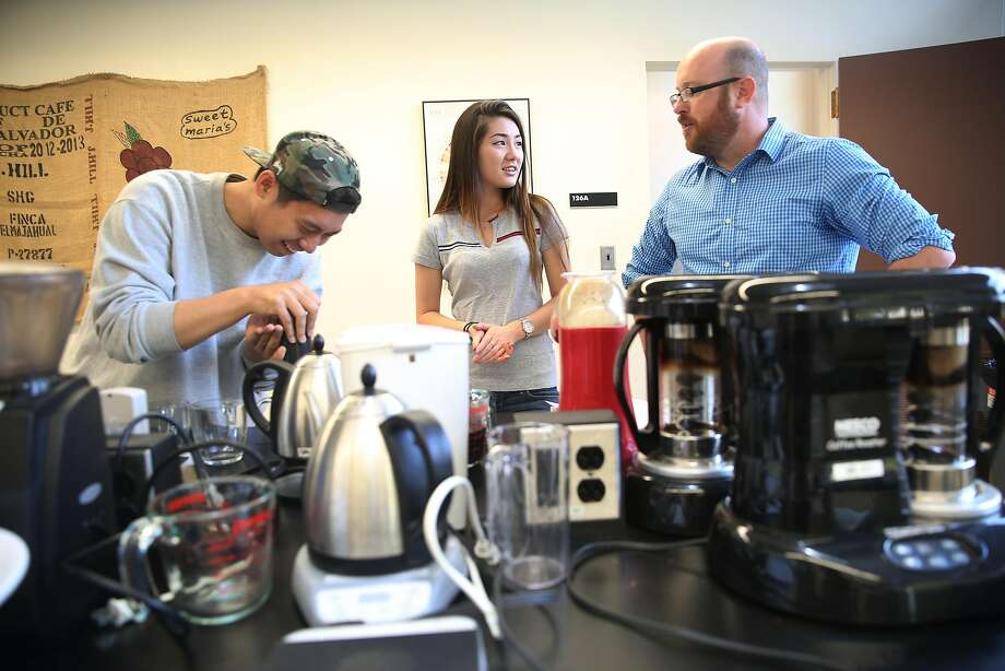 Professor Bill Ristenpart (right) with seniors Saeho Lee (left) and Roksana Pak compete in a classroom brewing contest. Photo: Liz Hafalia, The Chronicle