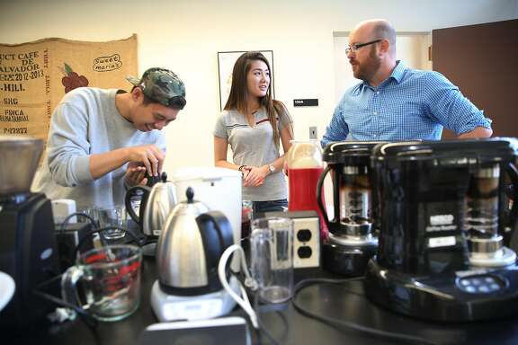 Professor Bill Ristenpart (right) with UCDavis seniors Saeho Lee (left) and Roksana Pak (middle) as they participate in a coffee brewing contest in their Design of Coffee chemistry class at UC Davis on Thursday, September 8, 2016, in Davis, Calif.  Peet�s Coffee is donating $250,000 to UC Davis to fund a pilot roastery for training and research, to help establish a coffee institute at the university.