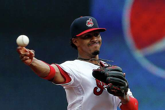 Cleveland Indians' Francisco Lindor throws out Houston Astros' Yulieski Gurriel  at first base during the first inning of a baseball game Thursday, Sept. 8, 2016, in Cleveland. (AP Photo/Ron Schwane)