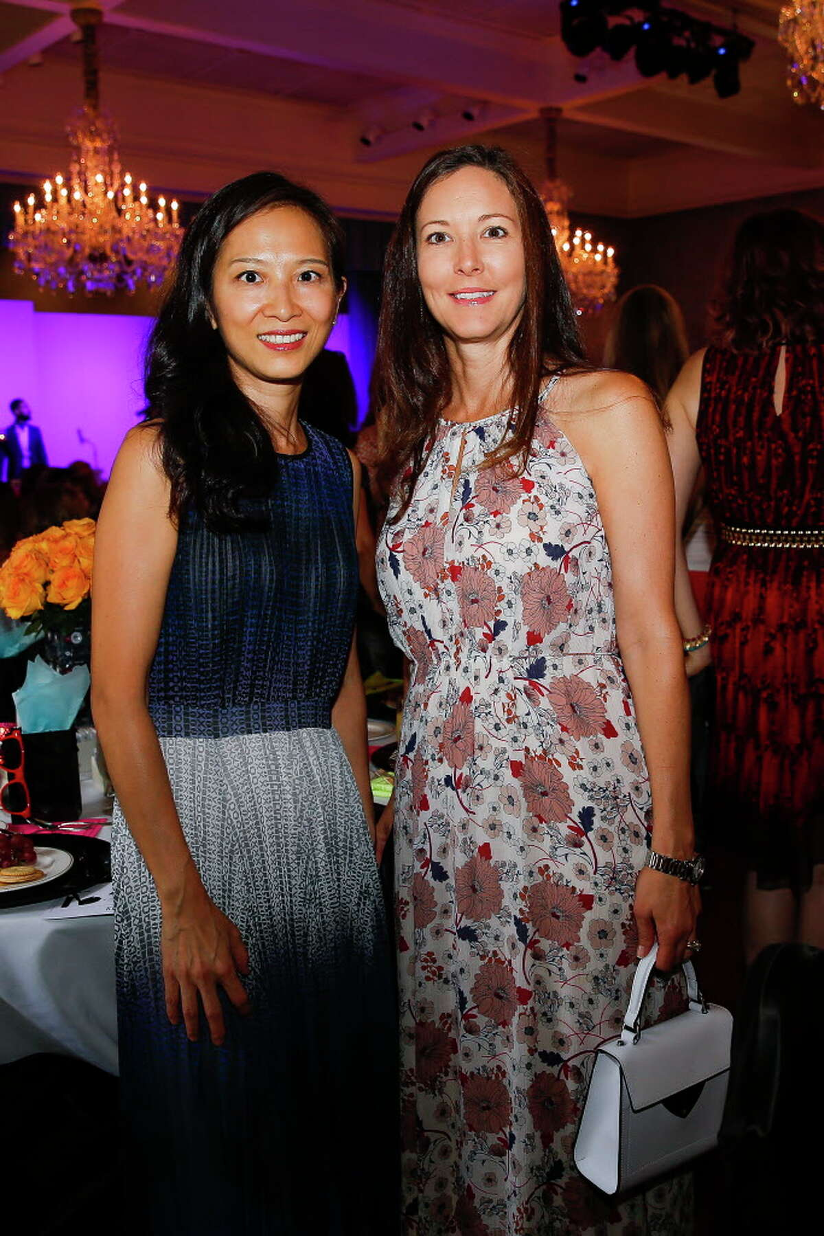 Leashing Guo, left, and Paula Mey at the Junior League 30th anniversary Opening Style Show Thursday, September 8, 2016 in Houston.