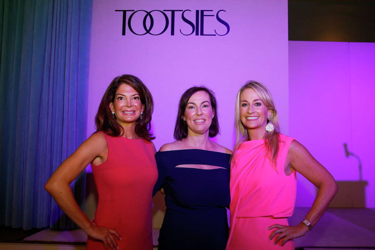 Junior League tea room director Whitney Walsh, left, president Shannon Wiesedeppe, center, and development vice president Amy Dunn at the 30th anniversary Opening Style Show Thursday, September 8, 2016 in Houston.