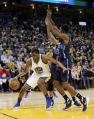 Kevon Looney (36) drives under the basekt in the first half as the Golden State Warriors played the Dallas Mavericks at Oracle Arena in Oakland, Calif., on Wednesday, January 27, 2016.