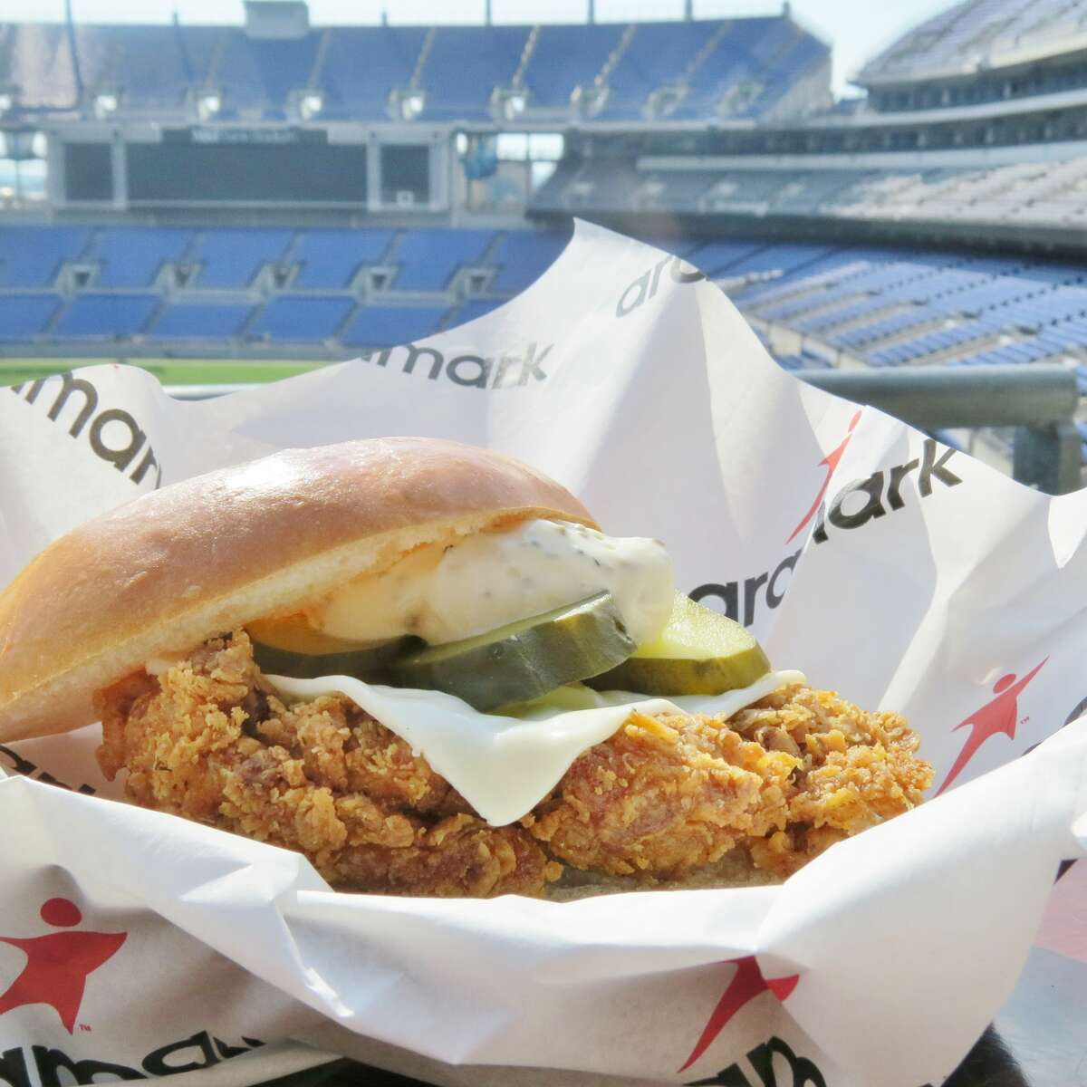 Yard Bird 2 - M&T Bank Stadium Pickle brined fried chicken breast with Monterey jack cheese, dill pickles and black pepper mayo on a brioche roll.
