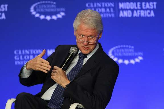 FILE - In this May 6, 2015, photo, former President Bill Clinton speaks during a plenary session at the Clinton Global Initiative Middle East & Africa meeting in Marrakech, Morocco. As Bill Clinton�s presidency ended, he was popular, yet still tainted by scandal, and struggling to find his footing after eight years in the White House. He eventually channeled his energy into the global philanthropy that bears his name and has shaped so much of his post-presidential legacy. (AP Photo/Abdeljalil Bounhar, File)