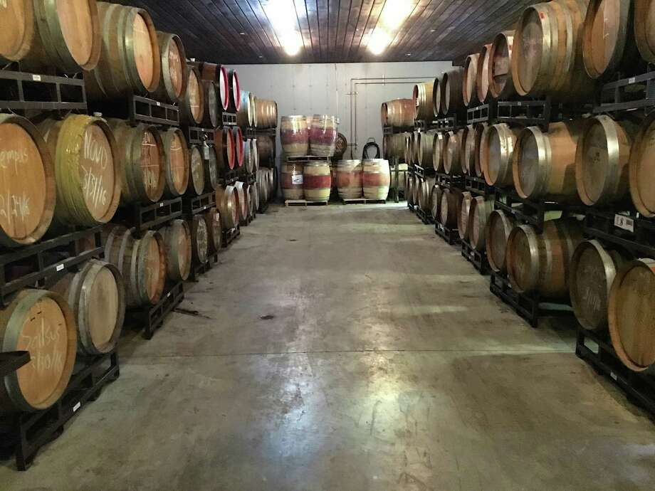 OEC Brewing has hundreds of beer barrels located in its barrel room in its Oxford campus. Photo: Tony Pellino /Contributed Photo