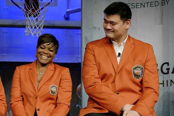 2016 class of inductees into the Basketball Hall of Fame Sheryl Swoopes, left, shares a light moment with Yao Ming, right, of China, during a news conference at the Naismith Memorial Basketball Hall of Fame, Thursday, Sept. 8, 2016, in Springfield, Mass. (AP Photo/Jessica Hill)