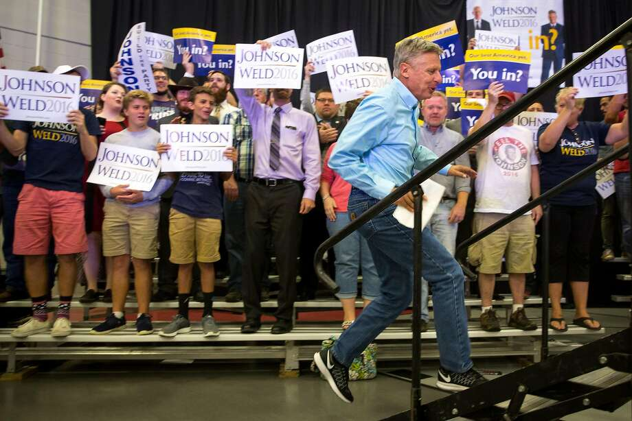"""Libertarian presidential candidate Gary Johnson runs to the stage at a rally in Iowa on Saturday. Thursday, he said """"What is Aleppo?"""" when asked about the city in Syria on MSNBC. Photo: Scott Morgan, Associated Press"""