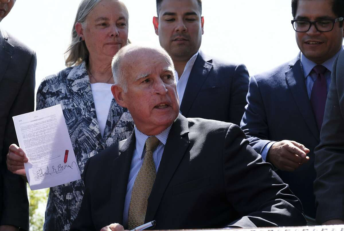 The two landmark climate bills signed Thursday by Gov. Jerry Brown cemented an unexpectedly strong alliance of labor unions, grassroots