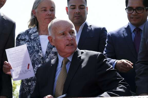 California State Sen. Fran Pavley, D-Agoura Hills, Calif., holds a bill signed by  Gov. Jerry Brown, after Brown signed legislation in Los Angeles on Thursday, Sept. 8, 2016. The law sets a new goal to reduce greenhouse gas emissions 40 percent below 1990 levels by 2030. (AP Photo/Richard Vogel)