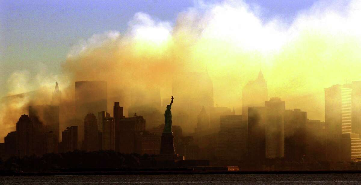 The Statue of Liberty stands before the smoke rising from Ground Zero after the September 11, 2001 terror attacks.