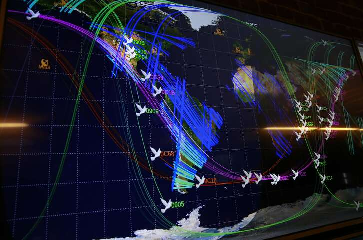 Huge screens show the positions of the dozens of satellites currently orbiting earth, seen at the Planet Labs Inc. headquarters in downtown San Francisco, Calif., on Thursday September 8, 2016, where they create shoe box size satellites that they send into space that gather photographs of earth.