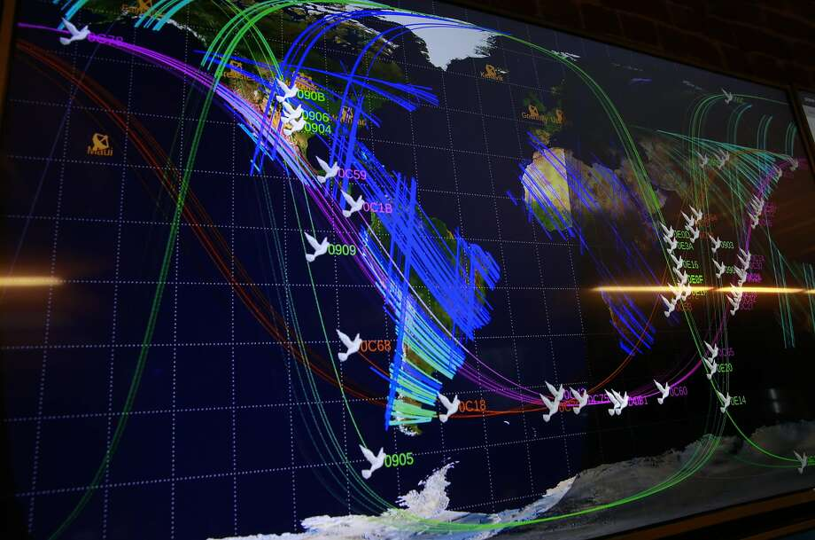 Huge screens show the positions of the dozens of satellites currently orbiting earth, seen at the Planet Labs Inc. headquarters in downtown San Francisco, Calif., on Thursday September 8, 2016, where they create shoe box size satellites that they send into space that gather photographs of earth. Photo: Michael Macor, The Chronicle