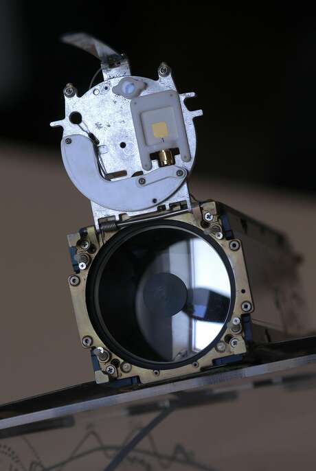 A telescope is inside a satellite that gathers images of Earth sits in the San Francisco headquarters of Planet, which creates shoe-box size satellites. Photo: Michael Macor, The Chronicle