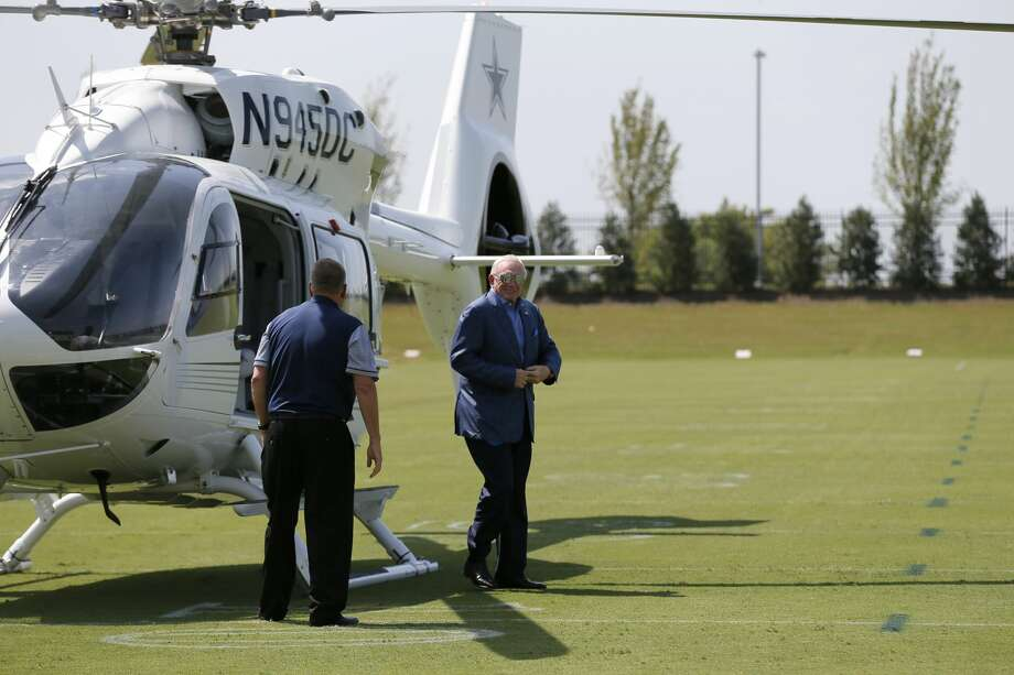 Dallas Cowboys team owner Jerry Jones, right, walks off his customized Airbus Helicopters H145 personal and corporate aircraft after arriving at the NFL football team's training facility and headquarters as pilot Gary Cook, left, stands by, Thursday, Sept. 8, 2016, in Frisco, Texas. (AP Photo/Tony Gutierrez) Photo: Tony Gutierrez/Associated Press