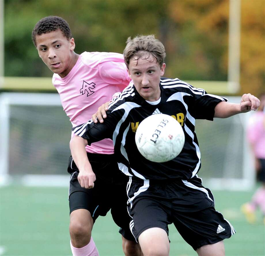 Abbott Tech's Christiano Dasilva (21), left,  and Kaynor Tech's Jacob Kalat (17) fight over the ball during the boys high school soccer game between Kaynor Tech and Abbott Tech High School, played at Broadview Middle School, Danbury, Conn, on Wednesday, October 15, 2014. Photo: H John Voorhees III / H John Voorhees III / The News-Times Staff Photographer