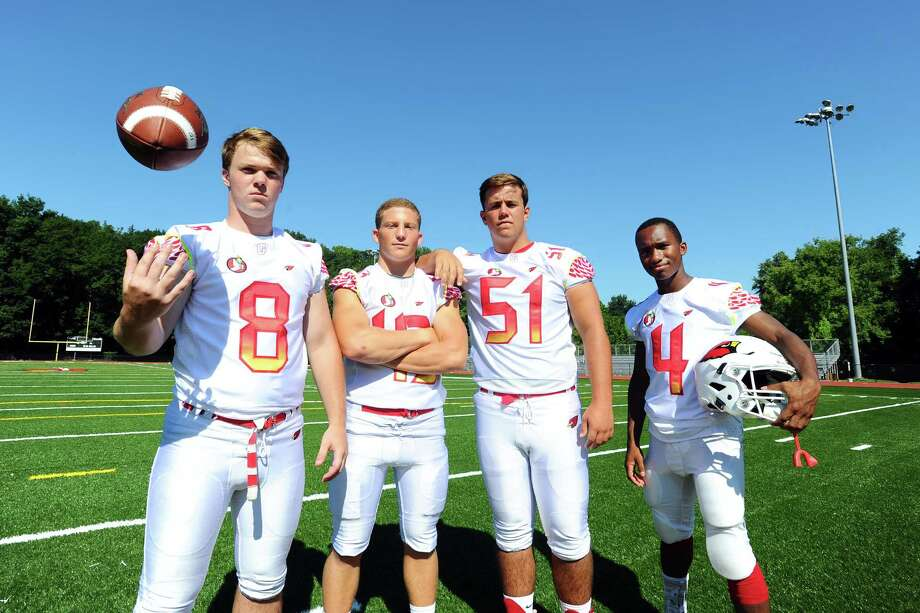 Greenwich High School football team captains, from left, linebacker Paul Williams, linebacker Mike Ceci, lineman Ben Krainger and wide receiver Tyler Farris at Cardinal Stadium in Greenwich, Conn. on Sunday, August 28, 2016. Photo: Michael Cummo / Hearst Connecticut Media / Stamford Advocate