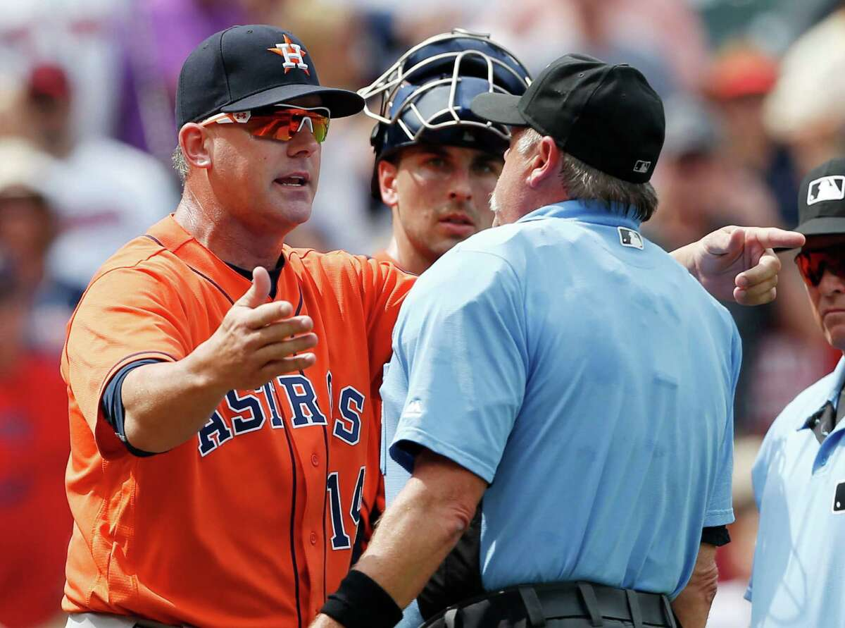 Astros manager A.J. Hinch, left, argues in vain to help umpire Jim Joyce see the error of his ways.
