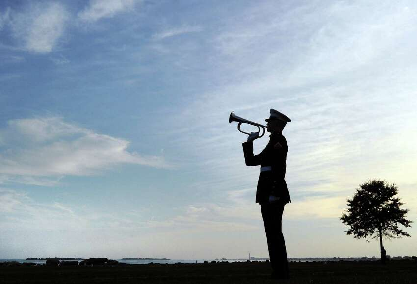 Lance Corporal Brian Drury of the U.S. Marine Corps, a Stratford resident, plays Taps during the 15th annual 9/11 Memorial Ceremony, honoring and celebrating the lives of those killed in the September 11, 2001 terrorist attacks at the 9/11 Memorial in Sherwood Island State Park in Westport,Conn., Thursday, Sept. 8, 2016.
