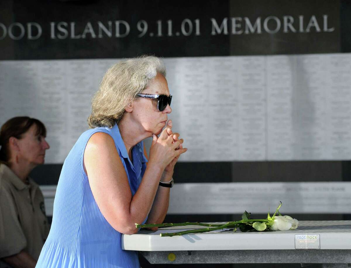 Cos Cob resident Diane Rasweiler in a moment of silence during the 15th annual 9/11 Memorial Ceremony, honoring and celebrating the lives of those killed in the September 11, 2001 terrorist attacks at the 9/11 Memorial in Sherwood Island State Park in Westport,Conn., Thursday, Sept. 8, 2016. Rasweiler said she lost her brother Roger Mark Rasweiler during the attacks.