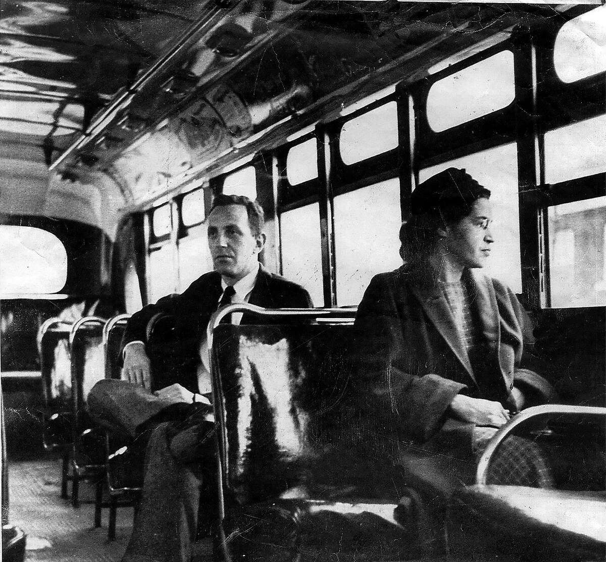 ** FILE ** This undated file photo shows Rosa Parks riding on the Montgomery Area Transit System bus. Parks, whose refusal to give up her bus seat to a white man sparked the modern civil rights movement, died Monday Oct. 24, 2005. She was 92. (AP Photo/Montgomery Advertiser)