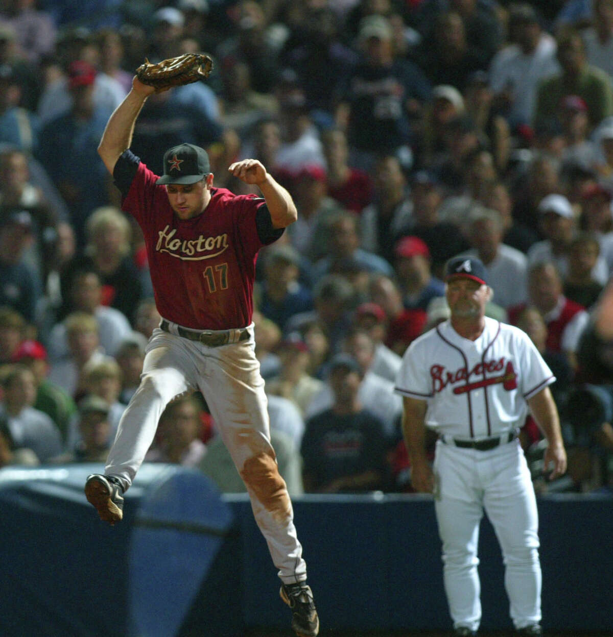 Lance Berkman leaps up to catch the ground ball hit by Andruw Jones during the 5th inning of Game Two of the National League Division Series, between the Houston Astros and the Atlanta Braves, at Turner Field in Atlanta, Georgia, Thursday, October 6, 2005(Karen Warren/Houston Chronicle)