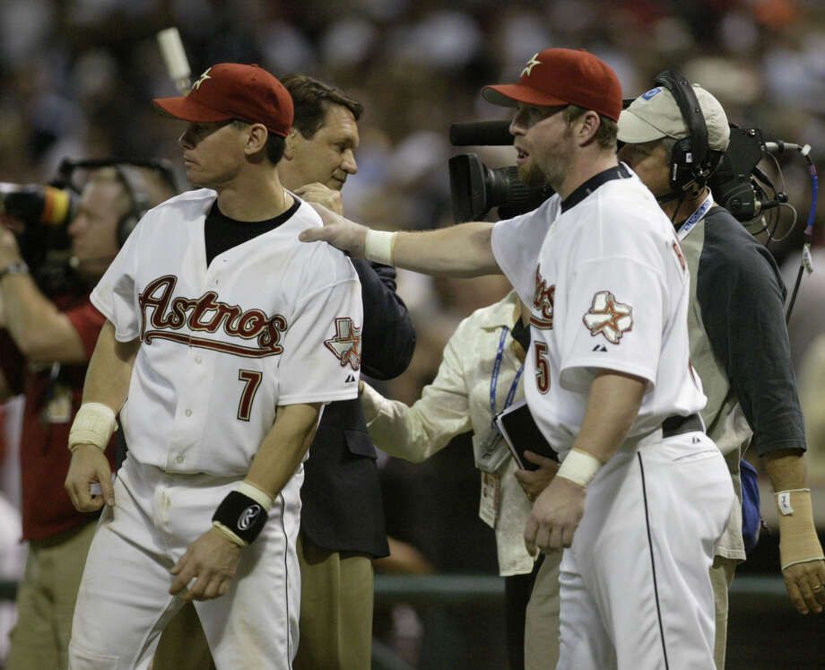 Craig Biggio and Jeff Bagwell celebrate after the Astros win the game 3-7 during the 9th inning between the Houston Astros and Atlanta Braves at Minute Maid Park, Saturday, October 8, 2005, during Game 3, of the National League Division Series. (Karen Warren/Houston Chronicle) Photo: Karen Warren, Staff / Houston Chronicle