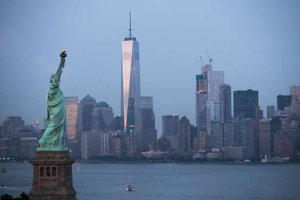 NEW YORK, NY - SEPTEMBER 8: in The Statue of Liberty stands in the foreground as Lower Manhattan is viewed at dusk, September 8, 2016 in New York City. New York City is preparing to mark the 15th anniversary of the September 11 terrorist attacks. (Photo by Drew Angerer/Getty Images)