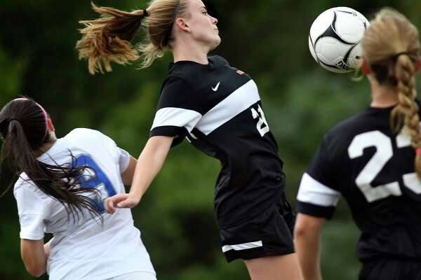 Bethlehem's Sydney Smith, center, chest bumps the ball during their soccer game against Shaker on Thursday, Sept. 8, 2016, at Shaker High in Latham, N.Y. (Cindy Schultz / Times Union)