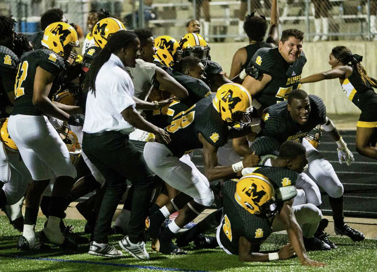 Sept. 8: Marshall 32, Klein 31 (OT) Fort Bend Marshall players mob running back Antonio Brooks after he ran across the goal line for a 2-point conversion to beat Klein 32-31 in overtime to win a non-district high school football game at Hall Stadium on Thursday, Sept. 8, 2016, in Missouri City.