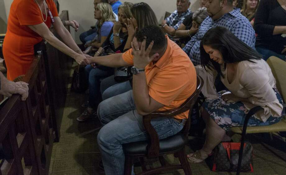 Justin Hall, center with hand on head, reacts Sept. 8 after a Bexar County jury convicted his mother, Frances Hall, of killing her husband and Justin's father, trucking tycoon Bill Hall Jr, in 2013 Justin is now seeking a share of the proceeds of some life insurance policies taken out by his father. Photo: William Luther /San Antonio Express-News / © 2016 San Antonio Express-News