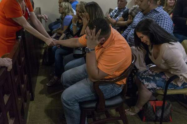 Justin Hall, center with hand on head, reacts Sept. 8 after a Bexar County jury convicted his mother, Frances Hall, of killing her husband and Justin's father, trucking tycoon Bill Hall Jr, in 2013 Justin Hall is now seeking a share of the proceeds of some life insurance policies taken out by his father.