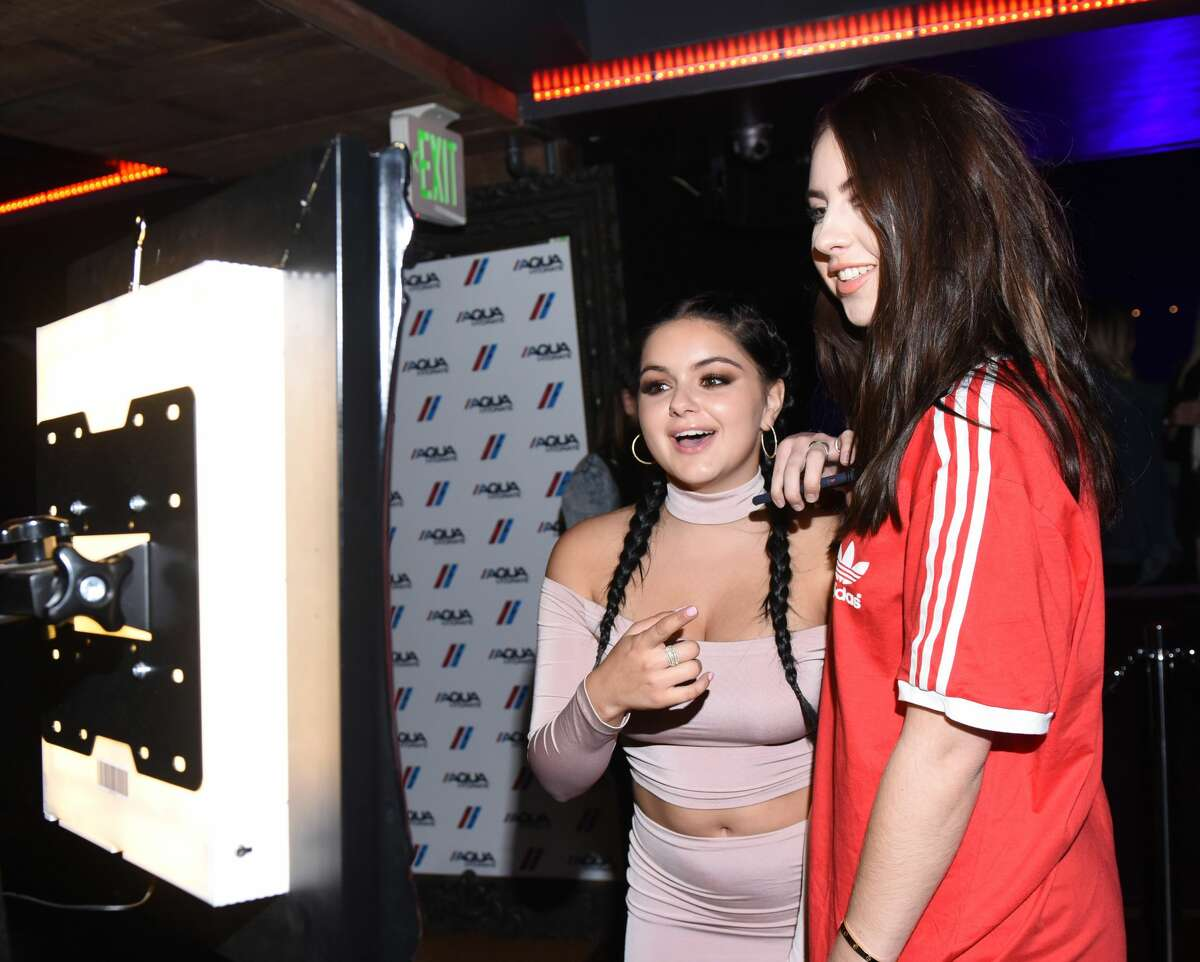 LOS ANGELES, CA - SEPTEMBER 07: Actress Ariel Winter and a guest attend a private event at Hyde Staples Center hosted by AQUAhydrate for the Drake and Future concert on September 7, 2016 in Los Angeles, California. (Photo by Vivien Killilea/Getty Images for AQUAhydrate)