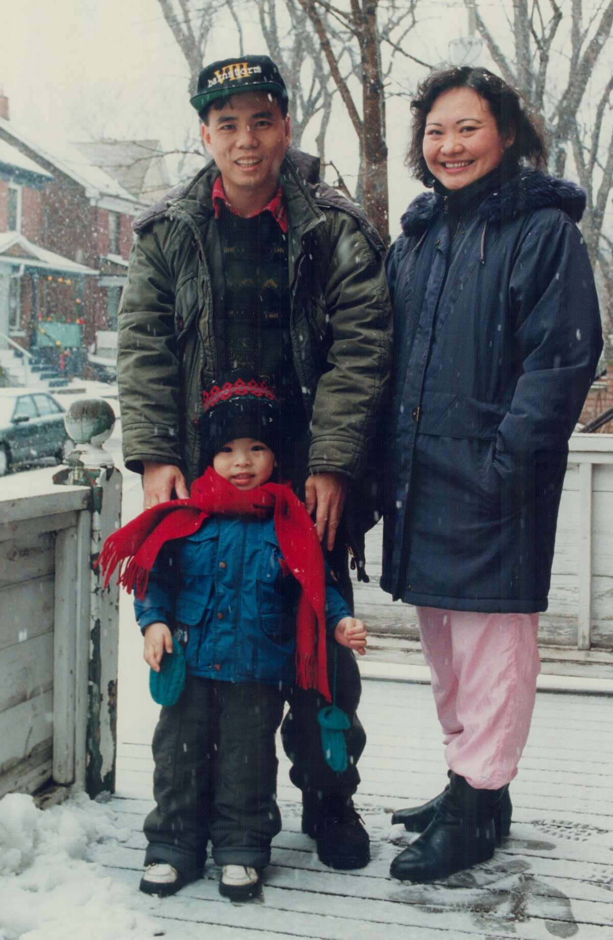 FILE--Kim Phuc; husband Huy Toan; and son Huy Hoang outside their Toronto home. She was the little girl, burned by napalm, seen running and screaming in pain in a Vietnam war picture that shocked the world.